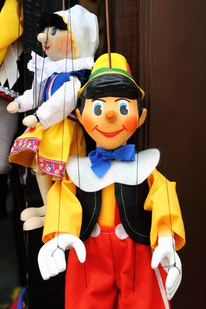 A smiling Pinocchio, the italian wooden puppet Editorial