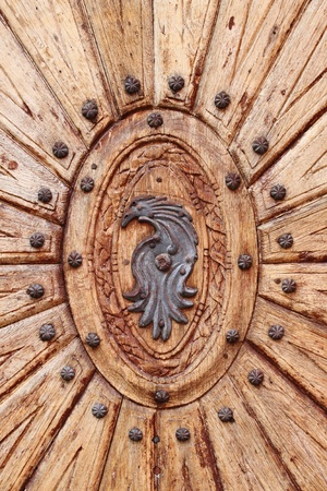 Detailed view of a wooden door with emblem Stock Photo - 11987478