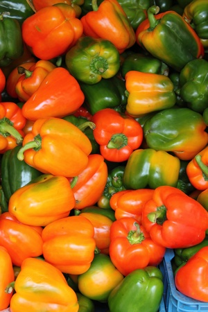 A bunch of fresh peppers for sale in a greengrocery photo