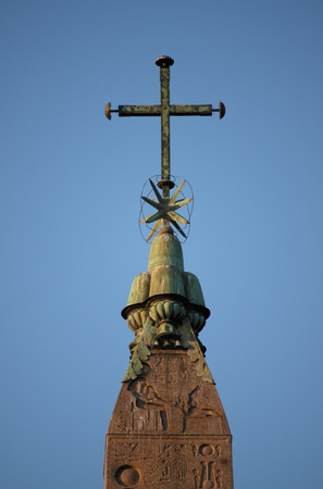 Cross on top of the egyptian obelisk in Popolo Square, Rome photo