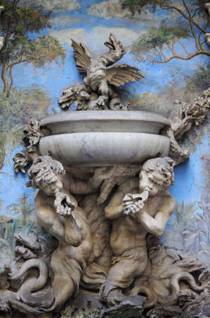 frescoed: Baroque fountain with two satyrs spitting water