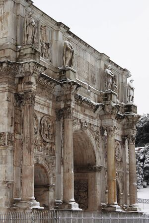 ROME - FEB 4: Arch of Constantine after the heavy snowfall on February 4, 2012 in Rome. The last snowfall in Rome was in 1985