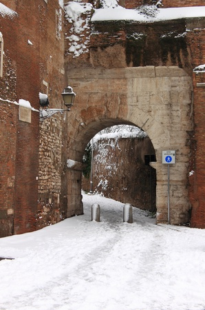 ROME - FEB 4: Medieval corner after the heavy snowfall on February 4, 2012 in Rome. The last snowfall in Rome was in 1985