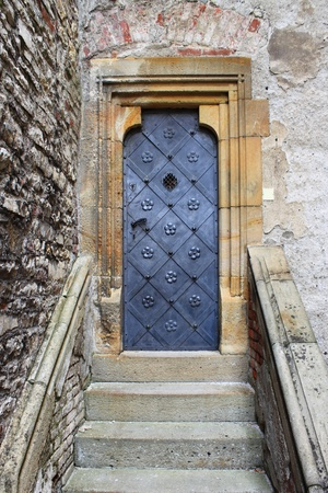 Medieval front door in the downtown of Prague, Czech Republic Stock Photo - 12541216