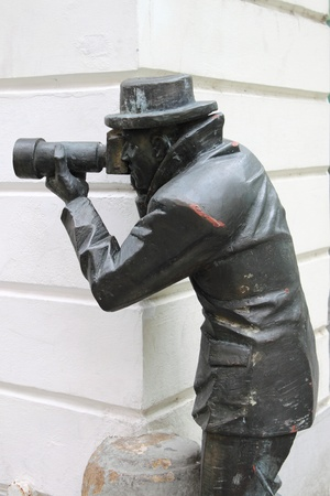 Bronze statue of a paparazzi taking pictures in Bratislava, Slovakia