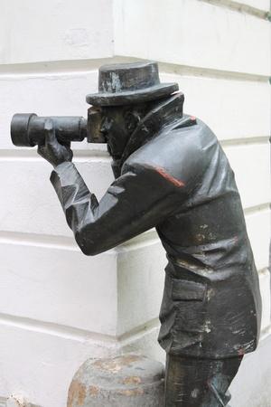 Bronzen standbeeld van een paparazzi nemen van foto's in Bratislava, Slowakije Stockfoto