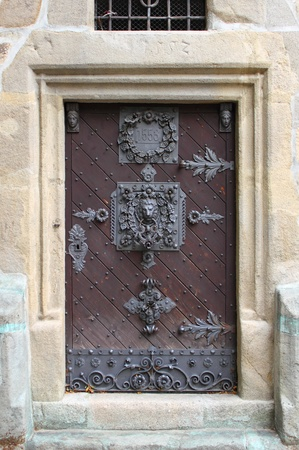 Medieval front door in the downtown of Prague, Czech Republic photo