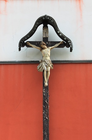 Ancient stone crucifix, symbol of christian faith photo