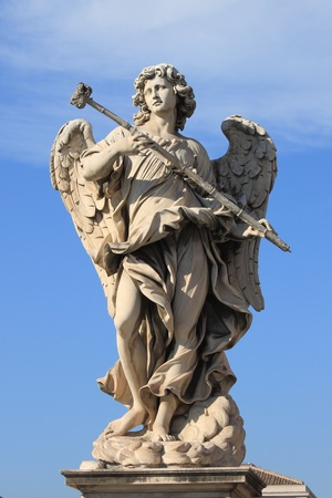 Angel statue in Saint Angel bridge  Rome, Italy photo