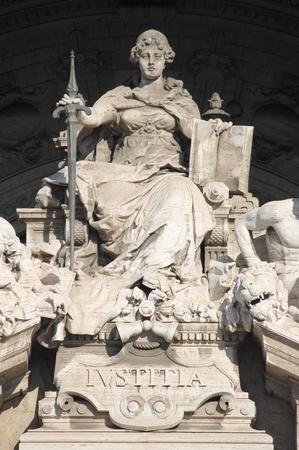 Statue of Justice Goddess in the Courthouse Palace of Rome, Italy photo