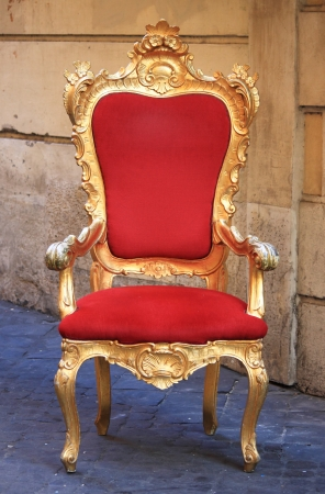 Emperor throne made with gold and red velvet photo