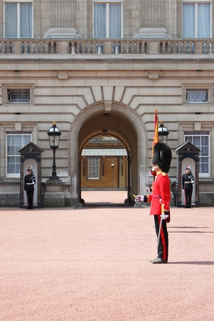 LONDON - MAY 5: British Royal guard performs the Changing of the Guard in Buckingham Palace on May 5, 2010 in London, UK