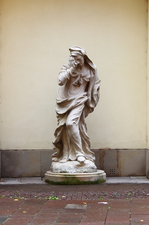 Marble statue of a crying woman photo