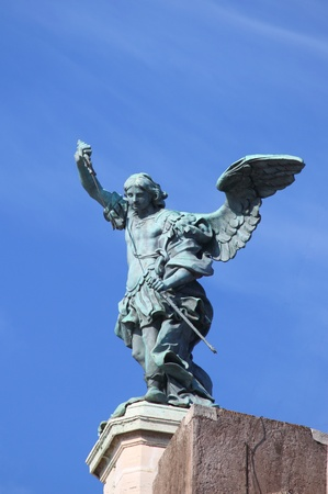 michael the archangel: Saint Michael Archangel statue on the top of Saint Angel castle in Rome, Italy