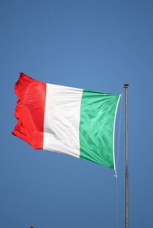 Italian green, white and red flag fluttering in the breeze photo