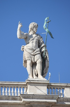 Statue of John the Baptist on the top of Saint Peter Basilica facade. Rome, Italy Stock Photo