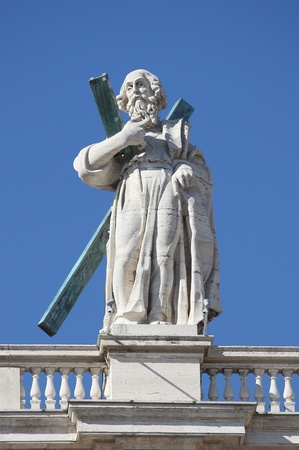 Statue of an apostle on the top of Saint Peter Basilica facade. Rome, Italy photo