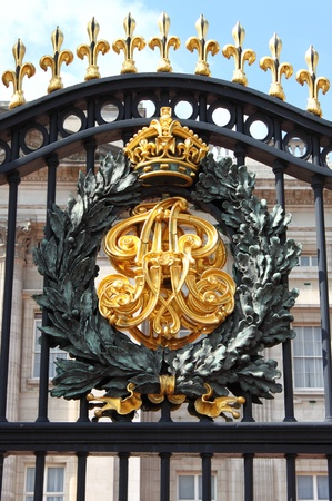 Emblem in the front gate of Buckingham Palace in London, UK