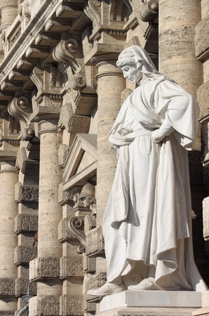 Statue of an thinker in front of the Palace of Justice in Rome, Italy photo