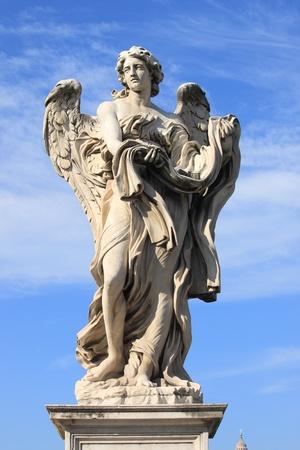 Angel statue in Saint Angel bridge  Rome, Italy photo