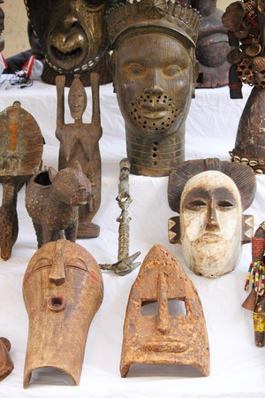 Traditional african masks sold in a market stall
