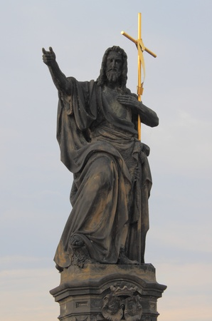 Saint John the Baptist statue in Charles bridge, Prague photo