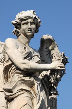 Angel statue in Saint Angel bridge. Rome, Italy photo