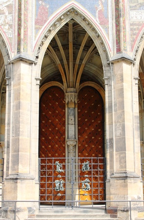 view of a wooden doorway: Gothic gate of St. Vitus cathedral in Prague, Czech Republic Stock Photo