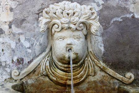 spitting: Renaissance fountain in Villa dEste of Tivoli, Italy