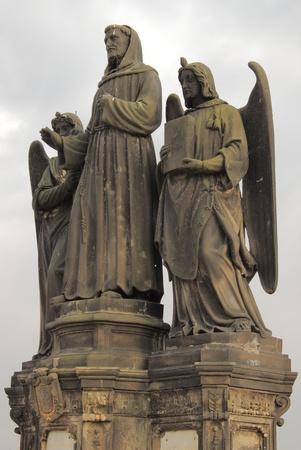 Statue of St. Francis Seraphic in Charles bridge, Prague photo