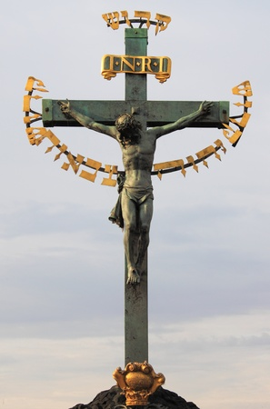 Statuary of St. Cross - Calvary - in Charles bridge, Prague photo