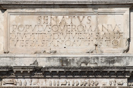 Main inscription in the Titus Arch. Rome, Italy