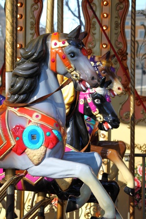 A horse in an old fashioned carousel photo