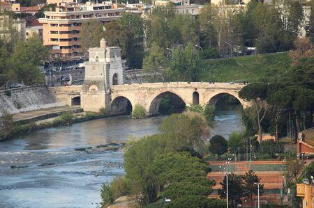 tiber: Milvio bridge over the Tiber river in Rome, Italy