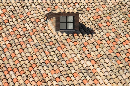 Mansard window in a old style roof Stock Photo - 13529571