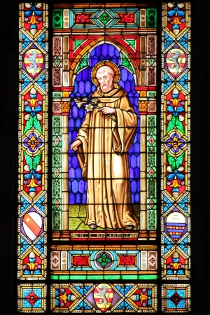 Stained glass window with a Saint photo