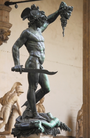 Statue of Perseus holding the head of Medusa in Florence, Italy photo