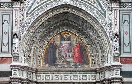 Virgin Mary mosaic in east portal of Florence cathedral. Italy photo