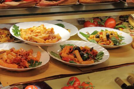 Several dishes of italian pasta  photo