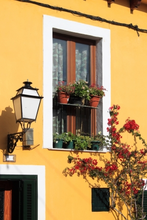 Facade of a mediterranean house with flowers photo