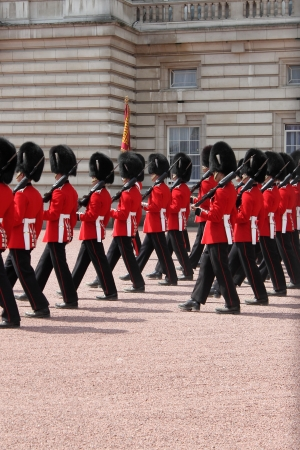LONDON - MAY 21: British Royal guards performs the Changing of the Guard in Buckingham Palace on May 21, 2010 in London, UK