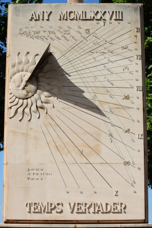 The sundial a means of telling the time from the sun rays photo