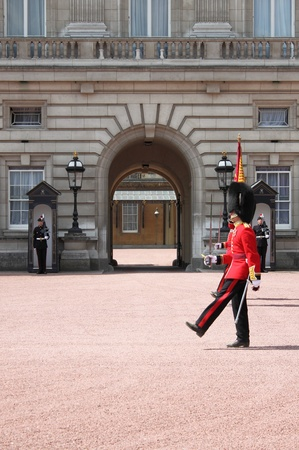 LONDON - MAY 21: British Royal guard performs the Changing of the Guard in Buckingham Palace on May 21, 2010 in London, UK