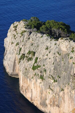 Vertical sheer cliff on the coastline in Mallorca, Spain photo