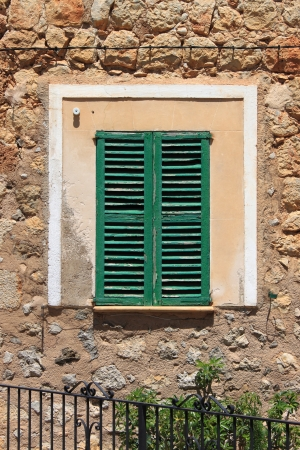 Italian style shutters in a old medieval palace Stock Photo - 14222658