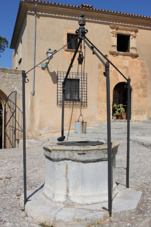 Medieval water well in Saint Salvador church in Arta, Spain photo
