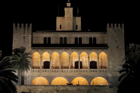 Almudaina Palace in Palma de Mallorca by night, Spain