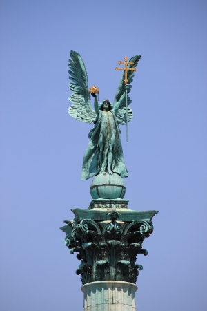 Archangel Gabriel statue in Heroes Square of Budapest, Hungary photo