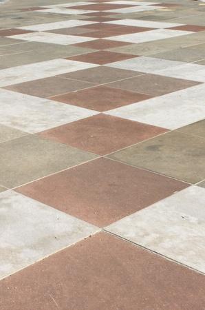 赤と白の市松模様の大理石の床のパターン