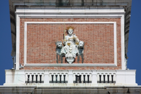 Statue of Justice Goddess in the Bell Tower of Venice, Italy photo